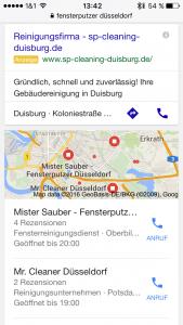 """Google Suchergebnisse für """"Fensterputzer Düsseldorf"""", zweites Bild (nach einmaligem Scrollen). Der zweite Bildschirm wird von der dritten Anzeige und dem Local Stack eingenommen."""